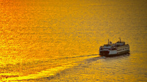 ferry on golden water
